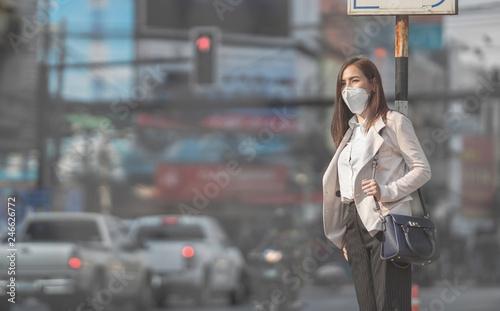 fototapeta na lodówkę Asian woman are going to work.she wears N95 mask.Prevent PM2.5 dust