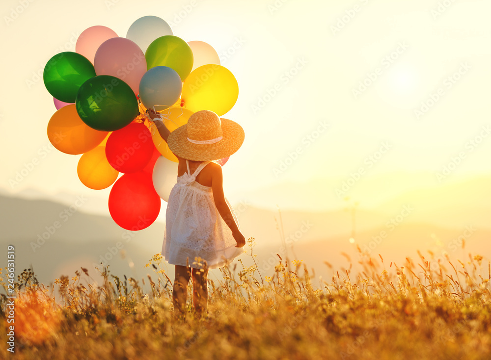 Fototapety, obrazy: . happy child with balloons at sunset in summer