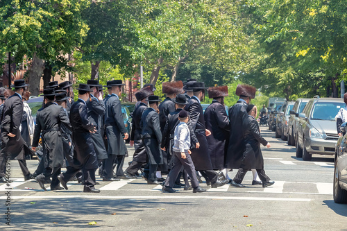 Fototapeta Orthodox Jews Wearing Special Clothes on Shabbat, in Williamsburg, Brooklyn, New York obraz