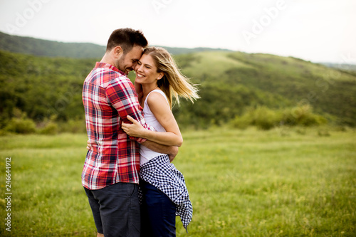 Fotografie, Obraz Loving embracing coulpe having fun in the spring nature