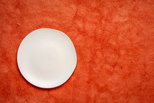White Plate On Textured Paper