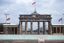 """Historic Image From July 1980: A Look From West Berlin Over The Berlin Wall To Brandenburg Gate And East Berlin. Sign With """"Caution: You Are Leaving West Berlin"""" In The Foreground. Scanned Slide."""