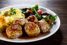 Roast Meatballs With Potatoes And Vegetable Salad