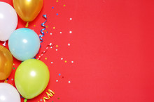 Flat Lay Composition With Balloons And Space For Text On Color Background
