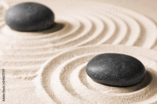Foto op Plexiglas Stenen in het Zand Zen garden stones on sand with pattern. Meditation and harmony