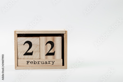 Fotografia  Wooden calendar February 22 on a white background