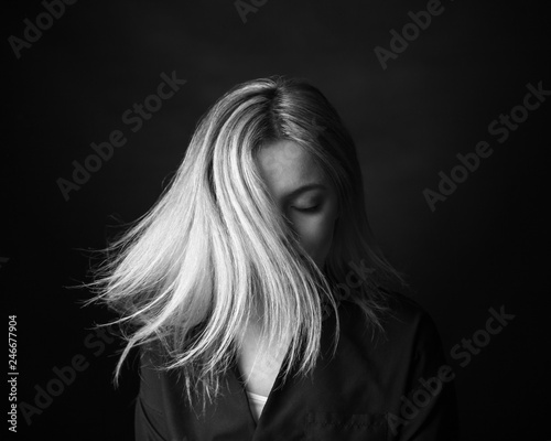 Tuinposter Kapsalon Dramatic black and white portrait of a beautiful woman on a dark background