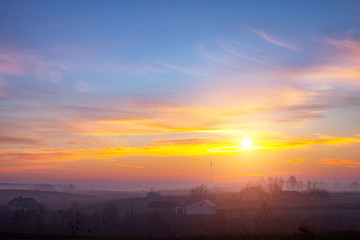 sunset in the field. beautiful autumn foggy landscape in Ukraine