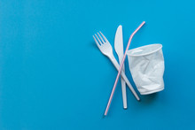 White Single-use Plastic And Plastic Drink Straws On A Blue Background. Say No To Single Use Plastic. Environmental, Pollution Concept.