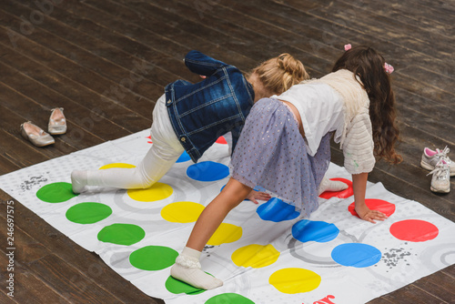Fotografie, Obraz  Two children playing twister on the floor