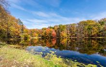 Autumn Colors Along A Small Lake In The Pocono Mountains Of Pennsylvania