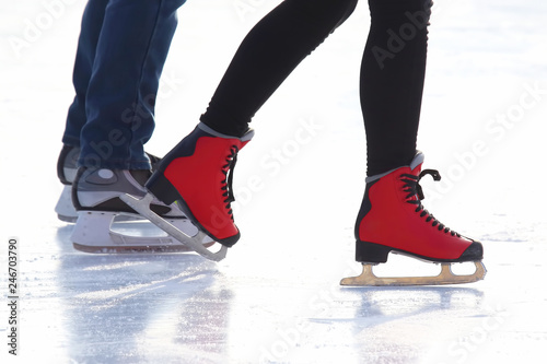 people skating on the ice rink