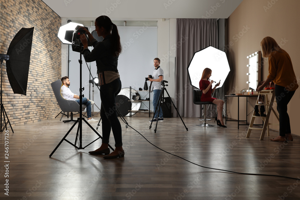 Fototapety, obrazy: Photo studio with professional equipment and team of workers