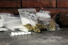 Hemp And Other Drugs In Packages On Grey  Table
