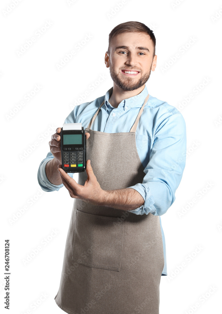 Fototapeta Young seller holding payment terminal isolated on white
