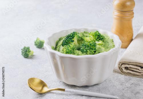 broccoli puree in a white bowl