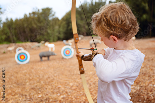Canvas Print kid practicing archery