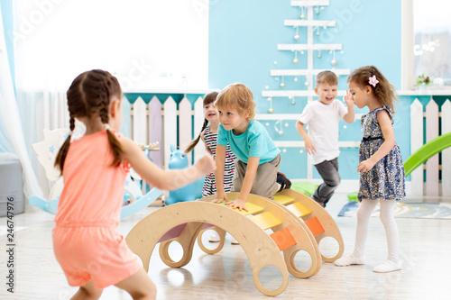 Staande foto Hoogte schaal Children playing in kindergarten or daycare centre