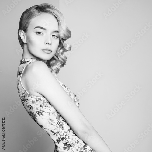 La pose en embrasure womenART Fashion studio portrait of beautiful blonde woman with classic makeup