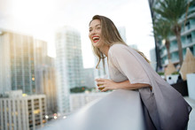 Atttractive Elegant Young Woman Having Fun Smiling On Rooftop Bar In City