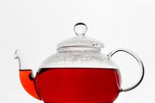 Glass Teapot With Hibiscus Karkade Tea At White Background