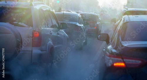 Photo  pollution from the exhaust of cars in the city in the winter