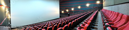 Photo  Screen and red velvet seats. Empty cinema. Mock Up. Premiere