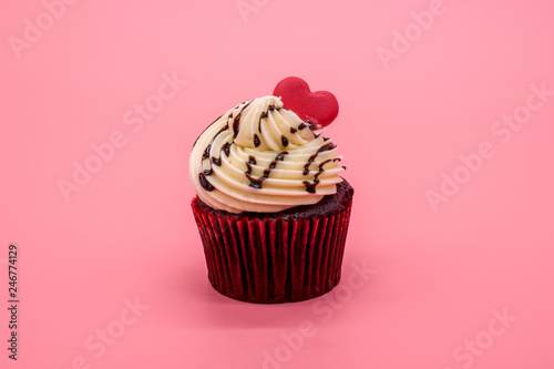 Chocolate cupcake with cream and berries decorated with fire flash Canvas Print