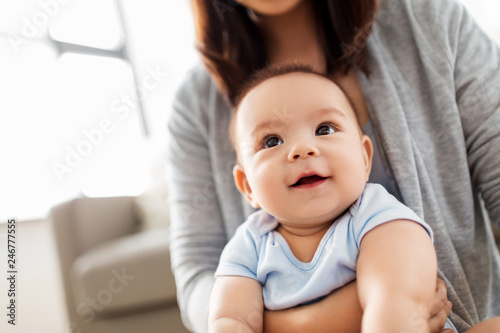 Obraz childhood and family concept - close up of asian baby boy with mother - fototapety do salonu