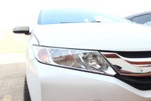 White Honda Car Headlight And Headlamps Close Up Sports Family