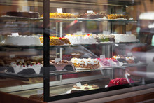 Appetizing Cakes In The Window Of A Pastry Shop. Tasty Sweets On The Baking Store Shelves