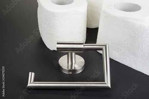 Fotografía  Toilet paper holder isolated on the black