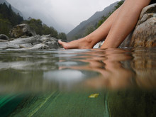 Feet On The Water Surface.
