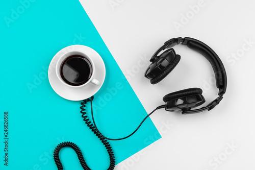 Fototapeta Stylish headphones on blue and white color background, top view. obraz na płótnie