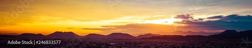 obraz lub plakat A panorama of a colorful sunset over the desert of the American Southwest in Arizona.