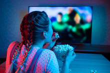 A Young Girl Watching Movies A...