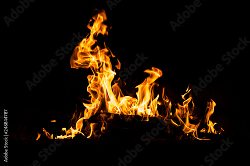 Door stickers Fire / Flame Fire flames burning isolated on black background. High resolution wood fire flames collection smoke texture background concept image.