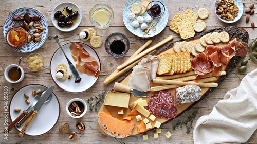 Foto op Plexiglas Voorgerecht Appetizers table with various of cheese, curred meat, sausage, olives and nuts Festive family or party snack concept. Overhead view.