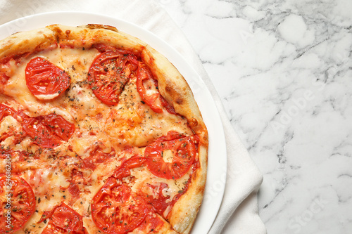 Hot cheese pizza Margherita on marble table, top view. Space for text
