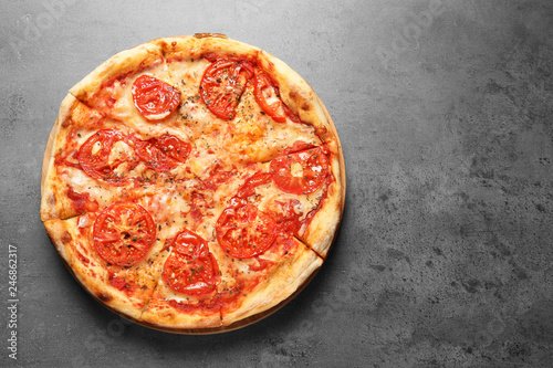 Hot cheese pizza Margherita on grey background, top view. Space for text