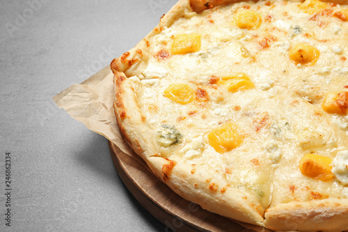 Hot cheese pizza Margherita on grey background, closeup. Space for text