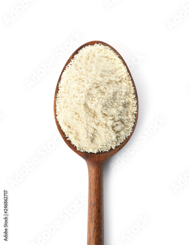 Spoon of sesame flour isolated on white, top view