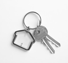 House Keys With Trinket On White Background, Top View