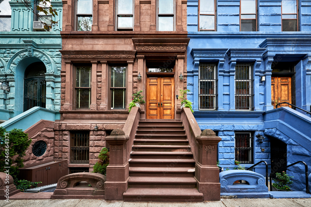 Fototapety, obrazy: a view of a row of historic brownstones in an iconic neighborhood of Manhattan, New York City
