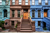 Fototapeta  - a view of a row of historic brownstones in an iconic neighborhood of Manhattan, New York City