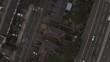 BIRDS EYE DRONE SHOT OF MOTORWAY & HOUSES