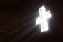 Light Goes Into A Wooden Church Through The Cross-shaped Window