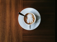 A Cup Of Cappuccino Top View, On Wooden Table