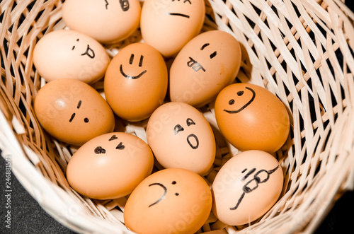 Eggs with smiling faces in the basket