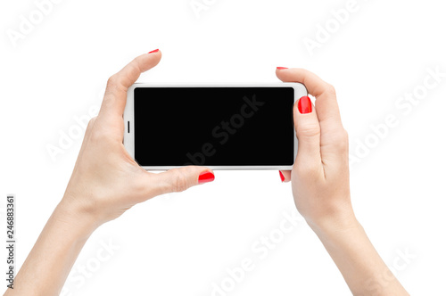 Fotografía  Woman's hands holding smartphone. Isolated on white.